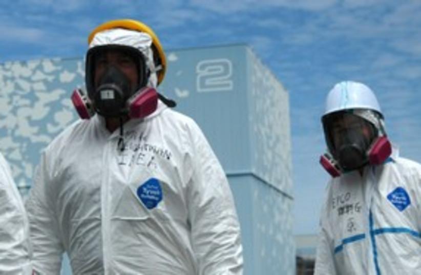 IAEA Insepctiors 311 R (photo credit: REUTERS)