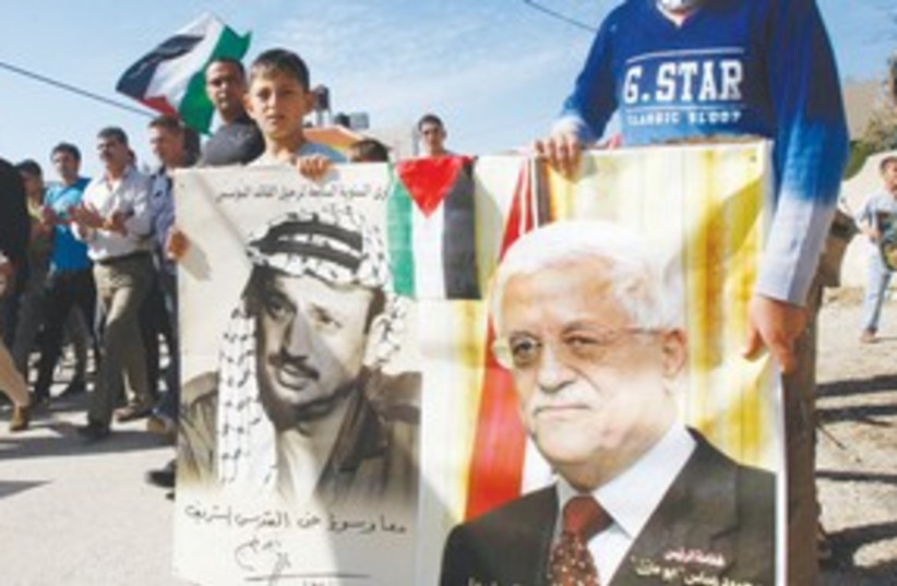 Placards of Arafat and Abbas 311 (R) (photo credit: REUTERS)