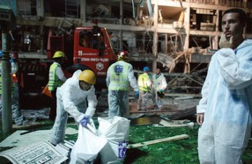 Rescue workers at Netanya gas explosion 311 (R) (photo credit: Reuters)