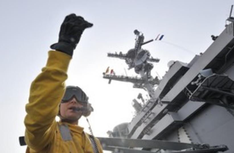 US Navy crew member 311 (R) (photo credit: Reuters)