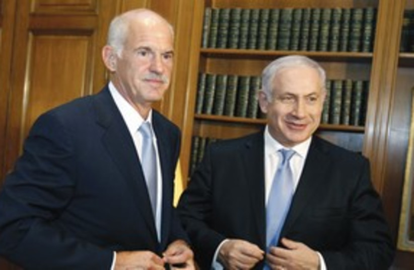George Papandreou with PM Netanyahu 311 (R) (photo credit: Reuters)
