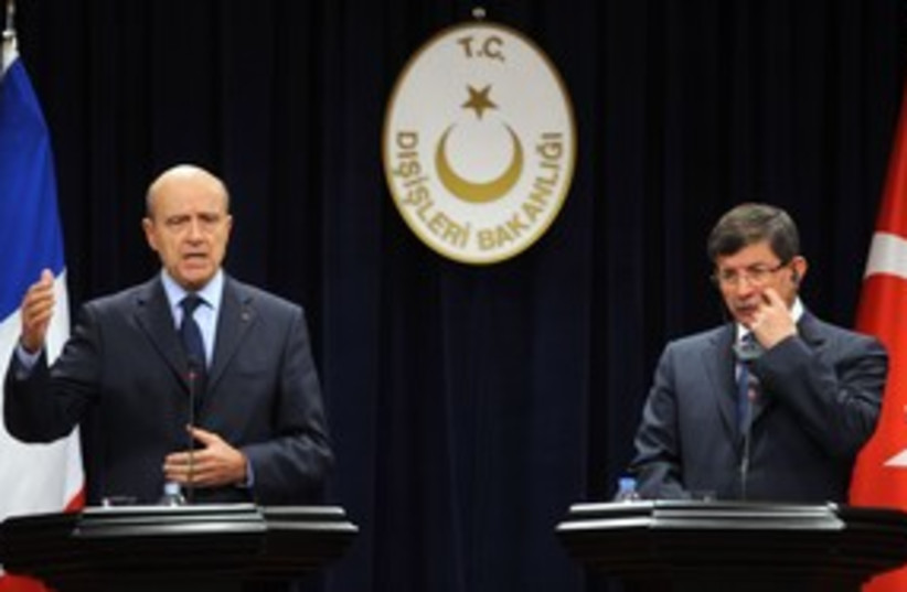 French, Turksih Foreign Ministers Juppe and Davutoglu_311 (photo credit: Reuters)