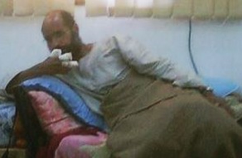 Saif al-Islam Gaddafi 311 (R) (photo credit: REUTERS/Libya Free TV via Reuters TV)