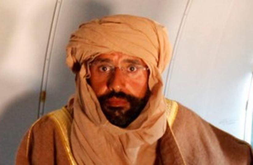 Saif al-Islam Gaddafi 311 (R) (photo credit: REUTERS/Ismail Zitouny)