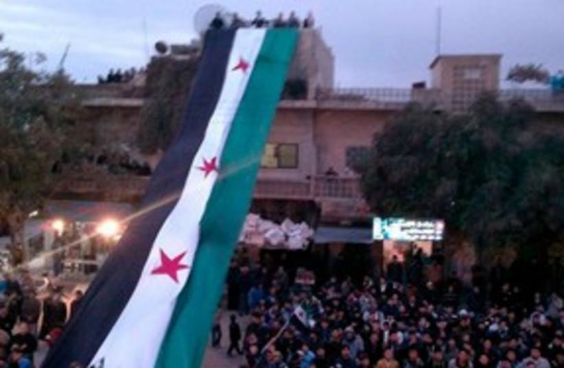 Syrian flag 311 (photo credit: REUTERS/Handout)