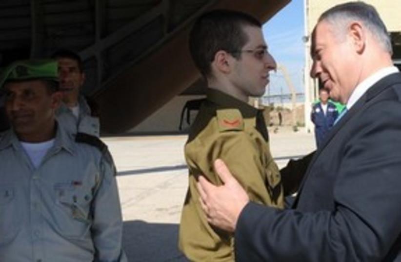Gilad Schalit  and Netanyahu (photo credit: GPO)