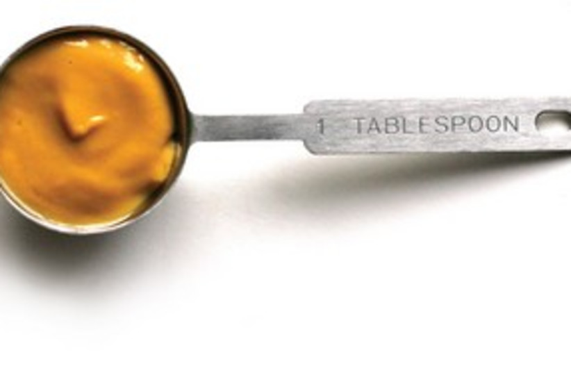 Mustard in tablespoon 311 (photo credit: courtesy/MCT)