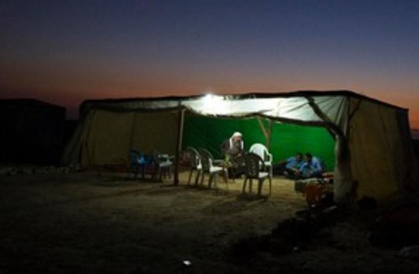 Beduin man in al-Arakib tent 311 (photo credit: REUTERS/Amir Cohen)