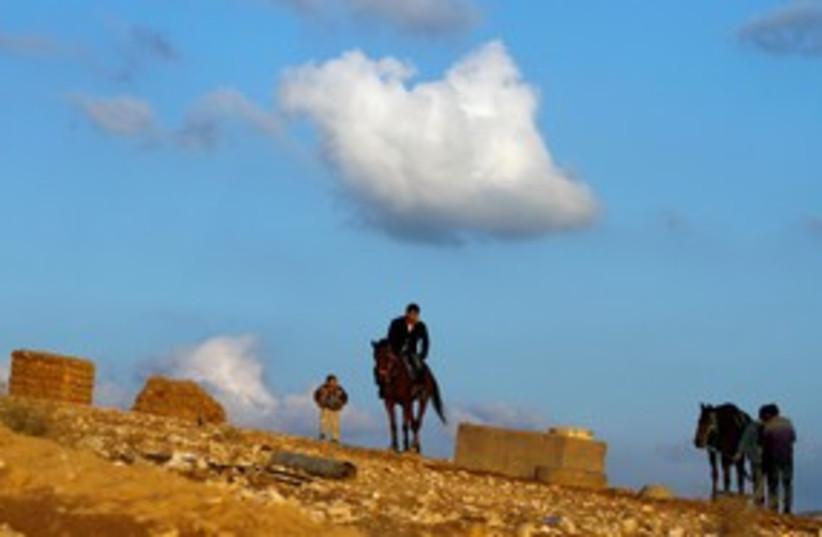 A Beduin man rides a horse in al-Arakib 311 (R) (photo credit: REUTERS/Amir Cohen)
