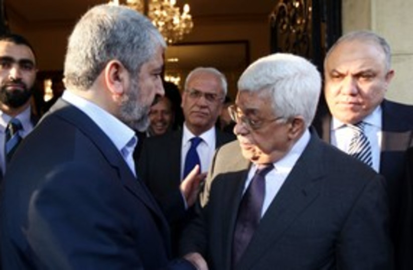 Abbas meets Mashaal in Cairo 311 (R) (photo credit: REUTERS/Mohamed Al Hams/Handout)