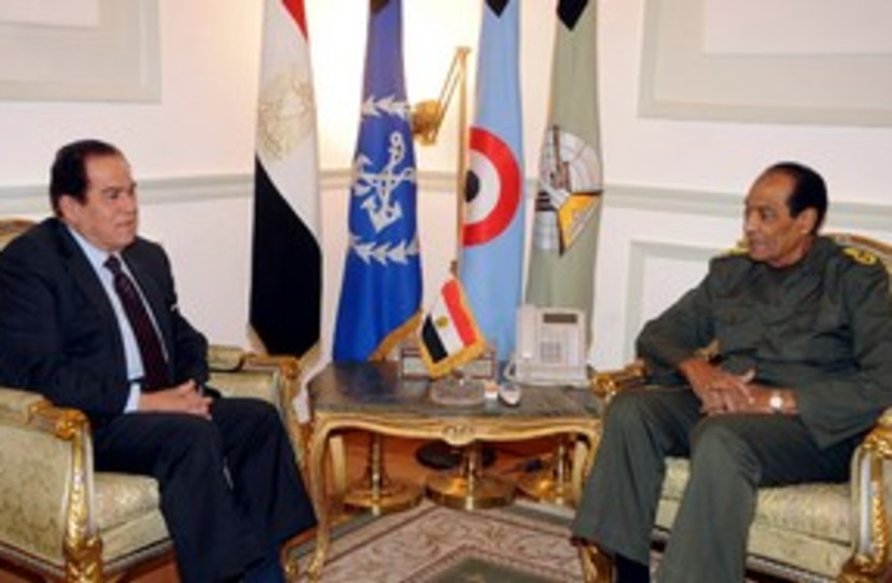 Tantawi meets with Ganzouri 311 (R) (photo credit: REUTERS/Middle East News Agency)