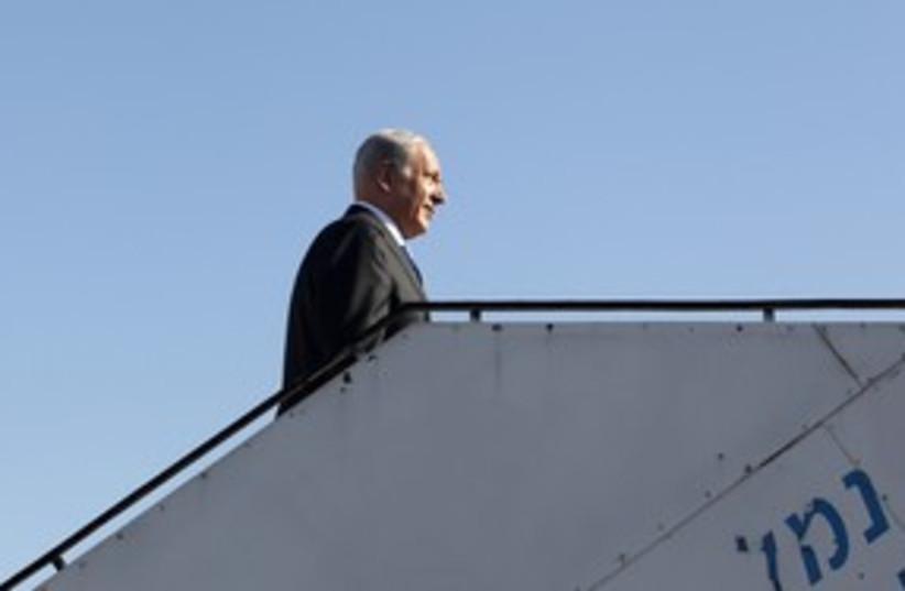 PM Netanyahu boards a plane 311 (R) (photo credit: Baz Ratner / Reuters)
