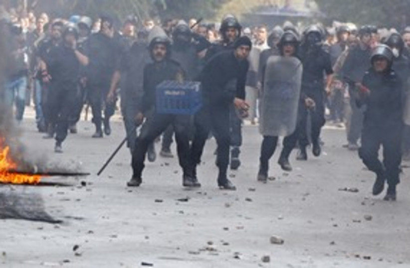 Riot police in Cairo Egypt 311 (R) (photo credit: REUTERS/Goran Tomasevic)