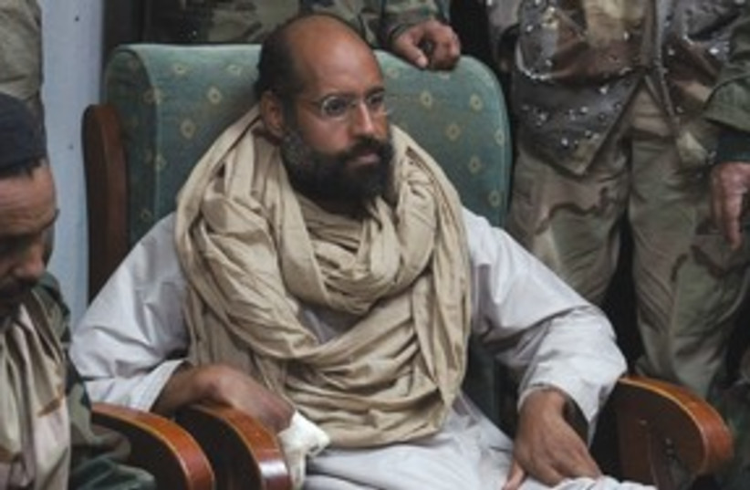 Saif al-Islam Gaddafi 311 (R) (photo credit: Ammar El-Darwish/Reuters)