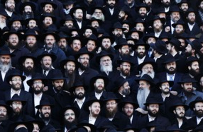 Chabad rabbis pose for group photo in Brooklyn 311 (photo credit: Reuters)
