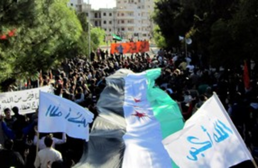Syria protests Homs 311 (photo credit: Reuters)