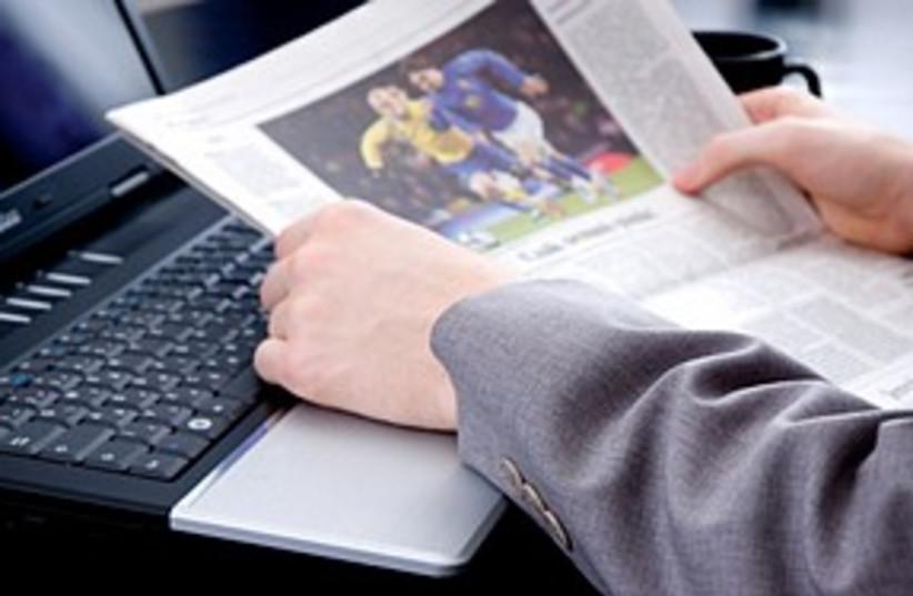 Newspaper laptop sports 311 (photo credit: Thinkstock/Imagebank [illustrative])