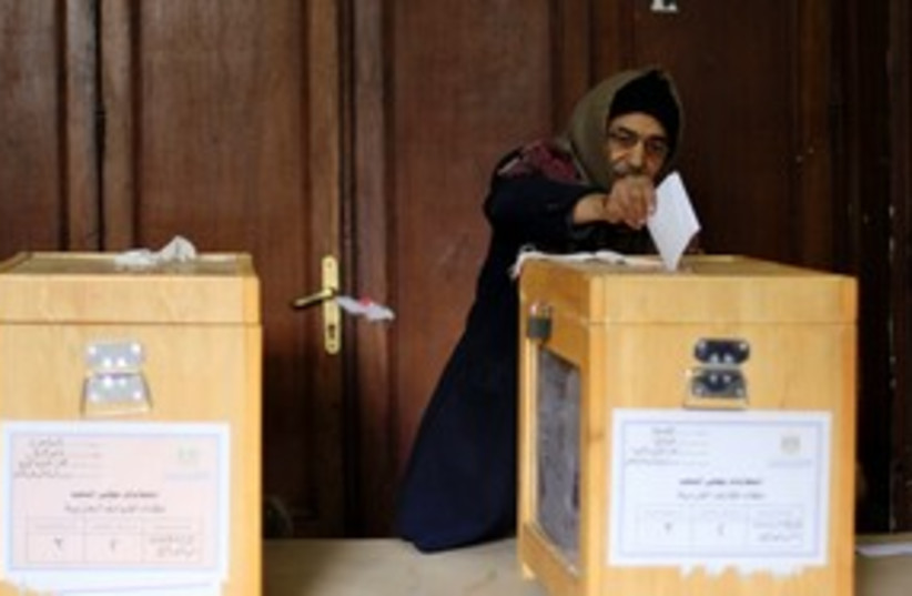 Egyptian man votes in  elections 311 (photo credit: Reuters)