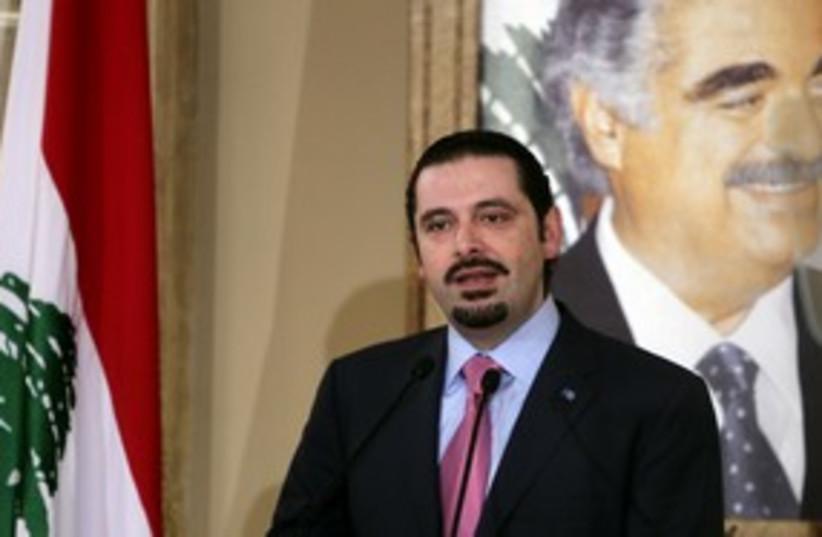 Saad Harir speaks in front of picture of Rafik 311R (photo credit: REUTERS/Mohamed Azakir)