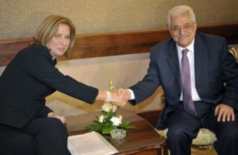 Tzipi Livni with Mahmoud Abbas OLD 311 (R) (photo credit: REUTERS/Amr Dalsh)