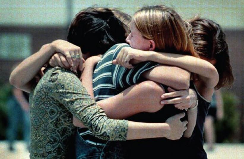 Girls hugging 521 (photo credit: MCT)