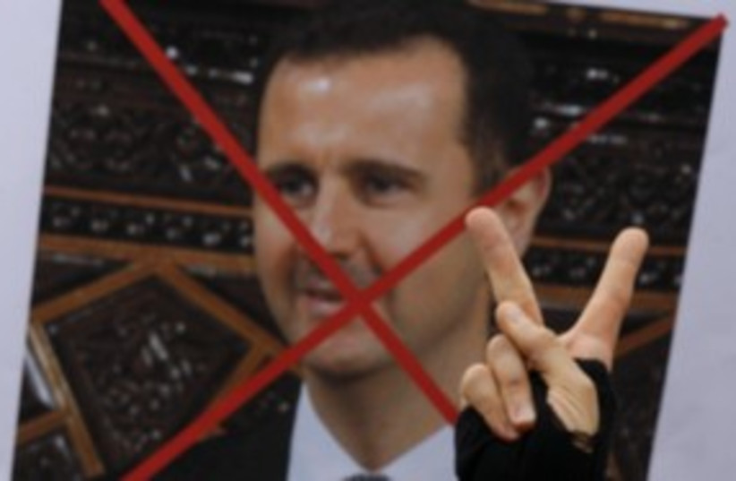 Protesters against Syrian President Bashar Assad 311 (R) (photo credit: Osman Orsal / Reuters)