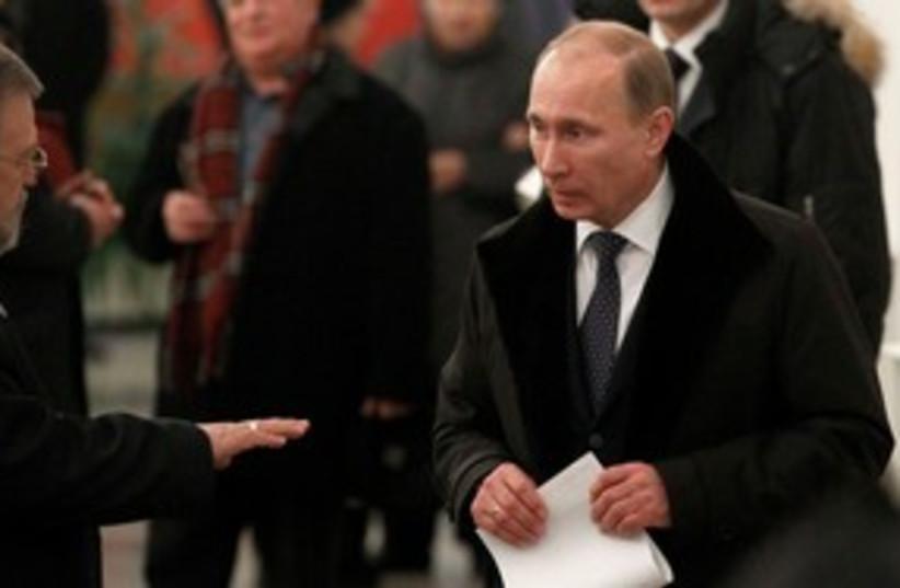Vladimir Putin casts his vote 311 (photo credit: REUTERS)