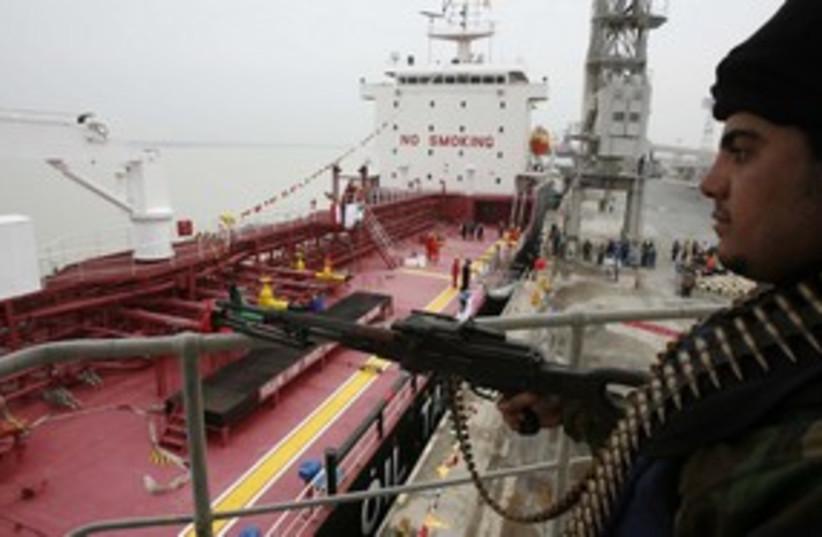 Policeman guards Iranian oil tanker 311 (photo credit: Reuters)