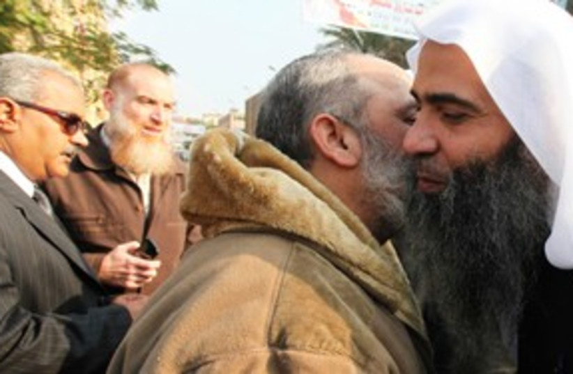 Nour party candidate Egypt Islamist kiss 311 (R) (photo credit: REUTERS/Amr Abdallah Dalsh)