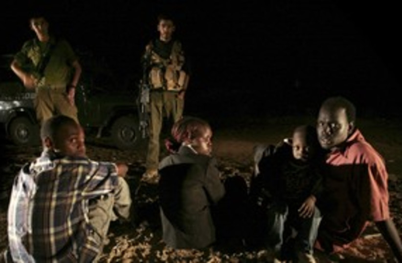 Sudanese detained after crossing southern border 311 (R) (photo credit: Yonathan Weitzman / Reuters)