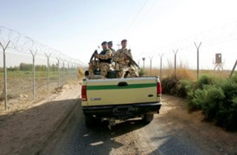 Iraqi patrol on Syrian border 311 R (photo credit: Reuters)