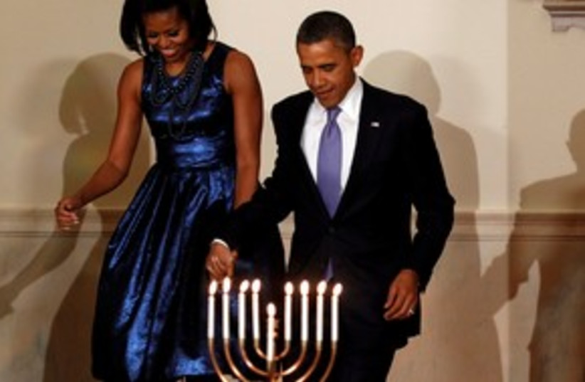 Obama and wife Michelle at White House Hannukah party 311 (photo credit: REUTERS)