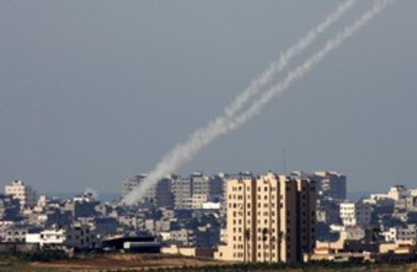 Kassam rockets being fired from the Gaza Strip 311 (R) (photo credit: Nikola Solic / Reuters)