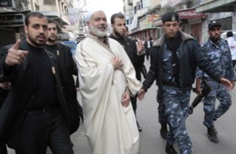 Haniyeh and bodyguards_311 (photo credit: Reuters/Ismail Zaydah)