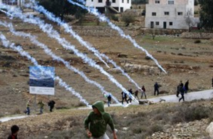 Nabi Saleh Palestinian protest, gas canisters_311 (photo credit: Reuters)