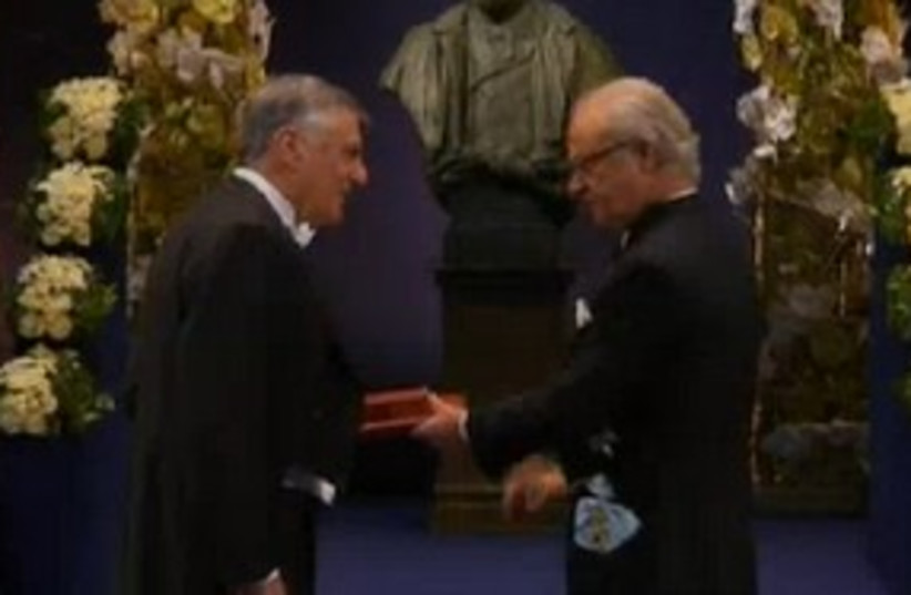 Dan Shechter is awarded the Nobel Prize 311 (photo credit: Channel 10)