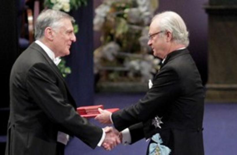 Prof. Dan Shechtman receiving the Nobel Prize 311 (R) (photo credit: REUTERS/Ints Kalnins)