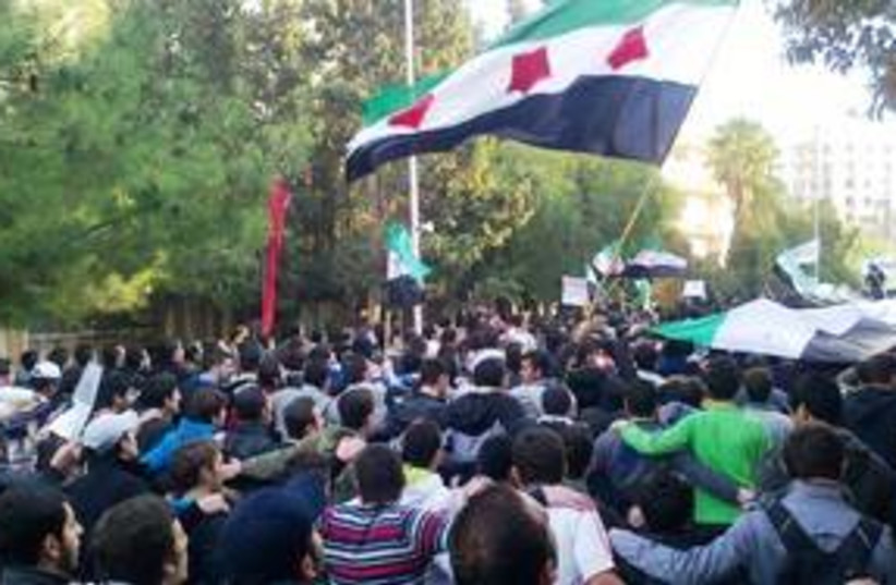 Anti-Assad protests in Homs, Syria 311 (R) (photo credit: REUTERS/Handout)