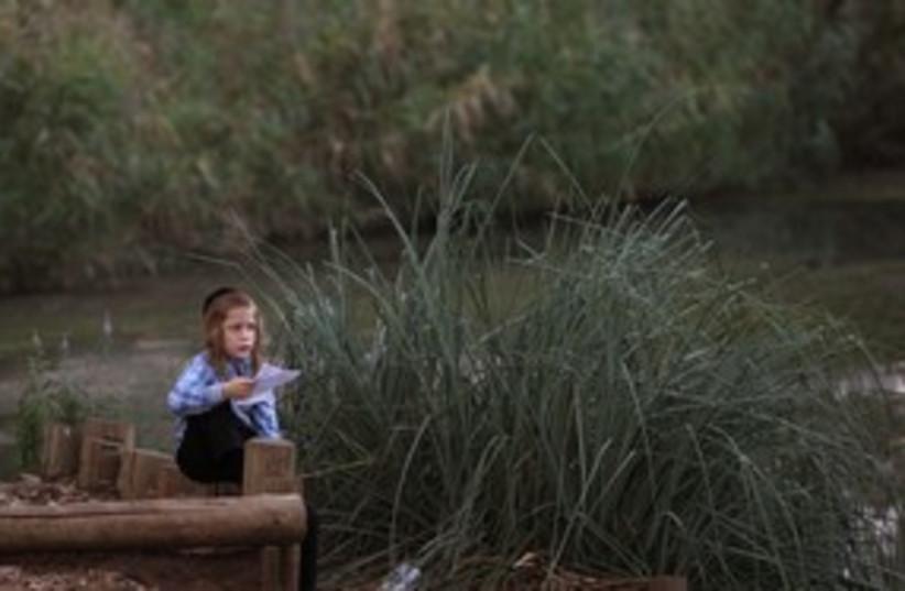 Baby moses at the Yarkon_311 (photo credit: Reuters/Gil Cohen Magen)