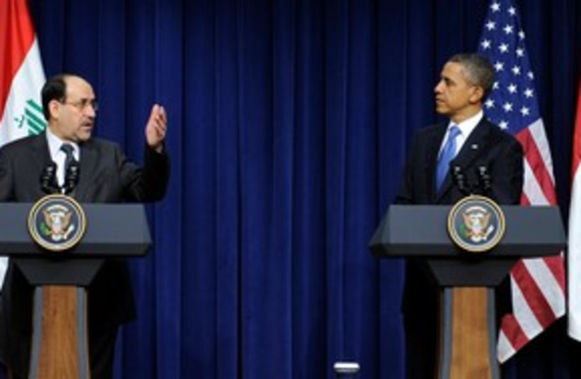 Obama at press conference with Maliki (R) 311 (photo credit: REUTERS Jonathan Ernst)