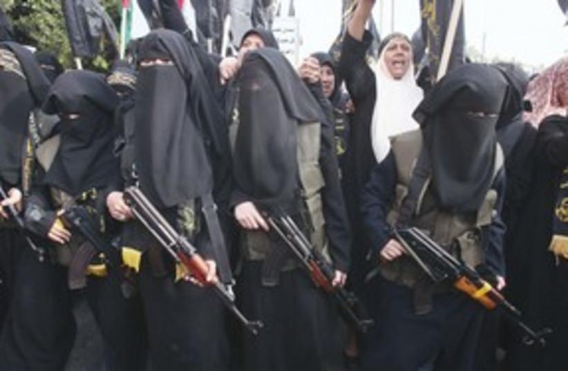 Muslim women with rifles, Gaza_311 (photo credit: Reuters)