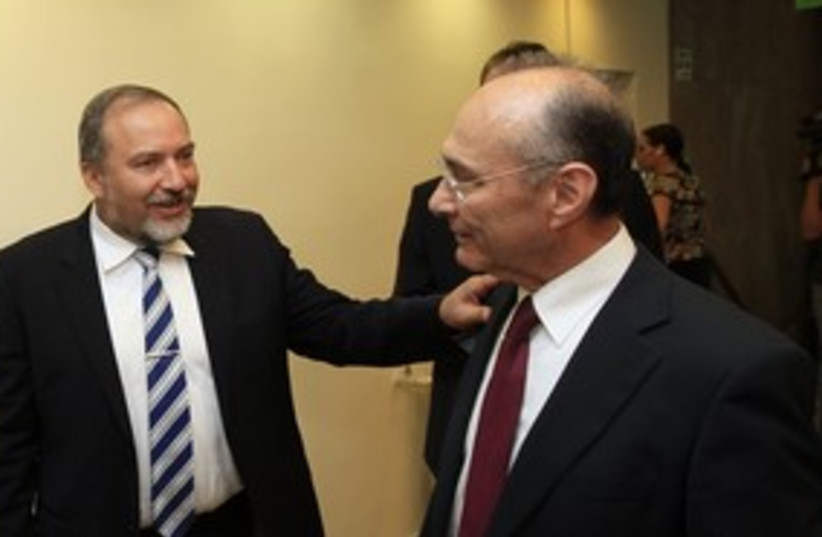 Uzi Landau (R) and Avigdor Lieberman (L)_311 (photo credit: Reuters)
