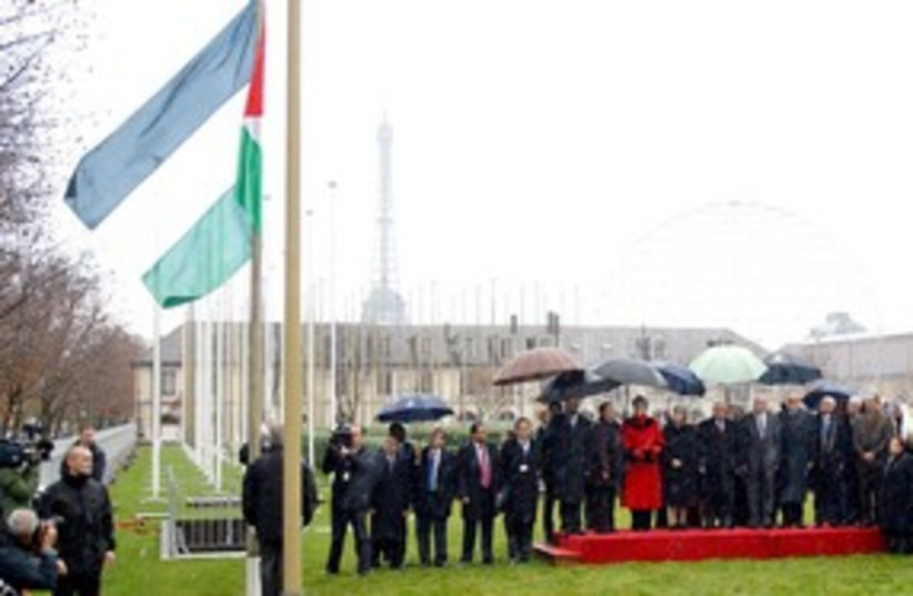 The Palestinian flag is raised at UNESCO in Paris 311 (R) (photo credit: REUTERS/Benoit Tessier)