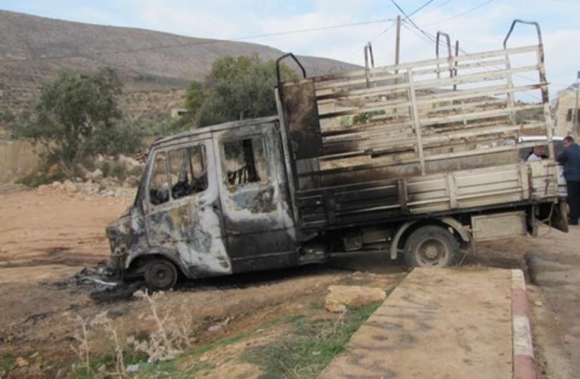 Palestinian vehicle set on fire price tag 311  (photo credit: Courtesy of Attaf Abu-Rov, B'Tselem)