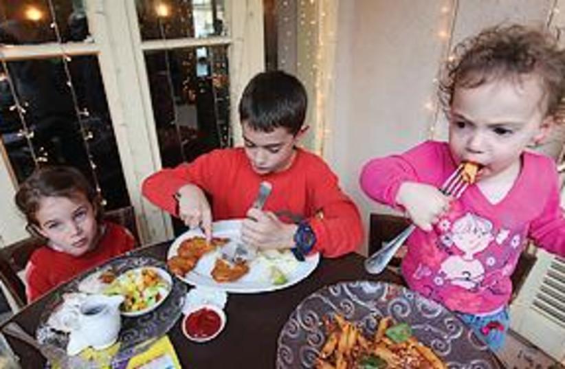 Children eating 311 (photo credit: Dudu Azoulay)