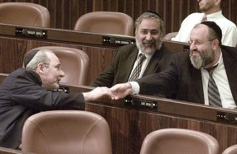 Rahamim Malol (L),Nissim Zeev (C) and Itzhak Saban (R), Shas (photo credit: Reuters/Nir Elias)