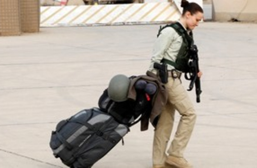 US soldier leaves Iraq 311 (photo credit: REUTERS)