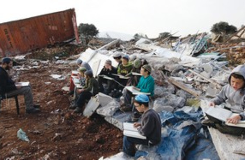 boy studies near destroyed home, Mitzpe Yitzhar_311 (photo credit: Reuters)