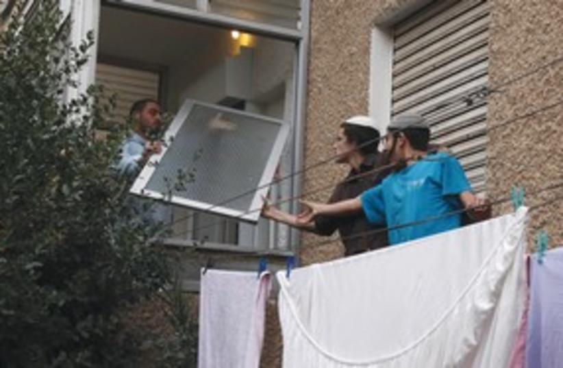 police stops activist from entering price-tag apt._311 (photo credit: marc israel sellem)