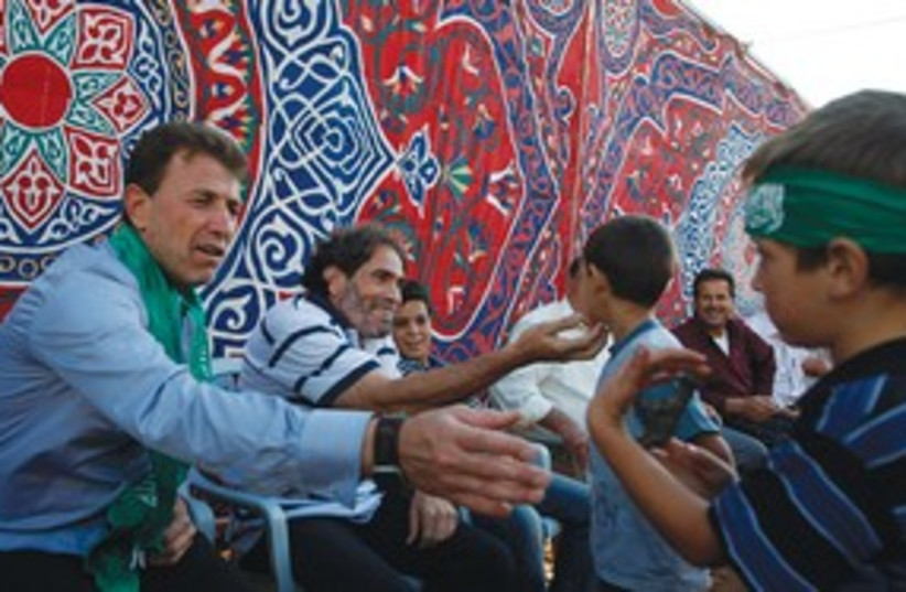 Freed Palestinian prisoner greets child_311 (photo credit: Reuters)